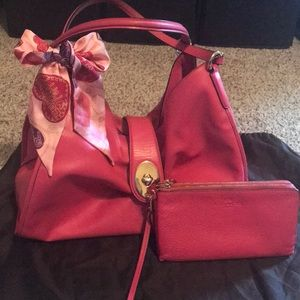 Leather Coach purse with matching wallet